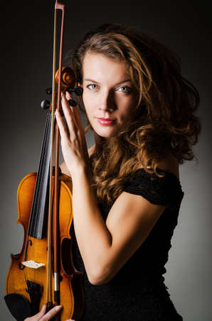 solo violinist: Woman performer with violin in studio