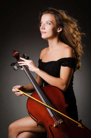 Woman performer with cello  in studio Stock Photo