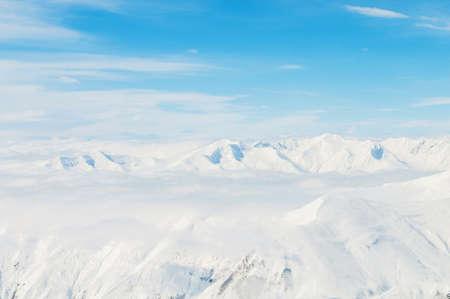 Snow mountains on bright winter day Stock Photo - 18013285