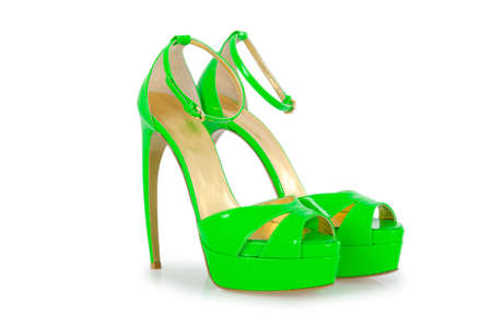 Woman green shoes isolated on white photo