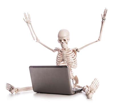 Skeleton working on laptop Stock Photo - 18012161