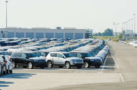 TUSCANY, ITALY - 27 June: New cars parked at distribution center in Tuscany, Italy. This one of biggest distribution centers in Italy. Stock Photo - 18017416
