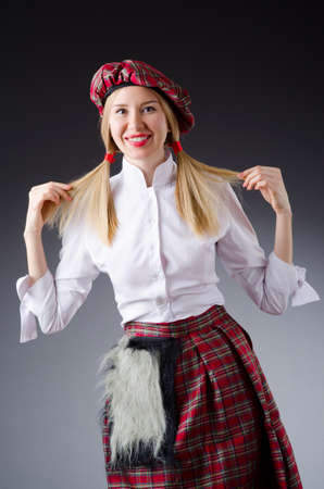 scottish female: Scottish traditions concept with person wearing kilt