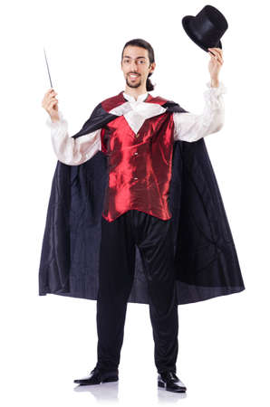 conjuror: Magician with his magic wand on white
