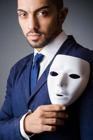 Man with black mask in studio Stock Photo - 18037690