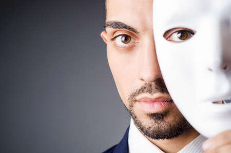 Man with black mask in studio Stock Photo - 18606099