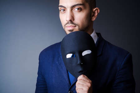 Man with black mask in studio Stock Photo - 18037088