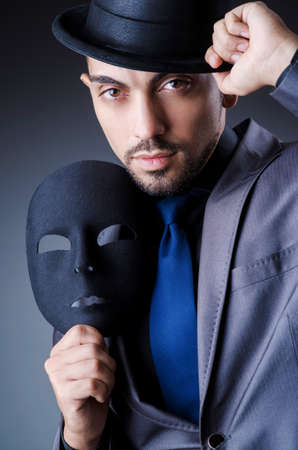 Man with black mask in studio Stock Photo - 18037042