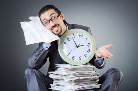 Man with clock and pile of papers Stock Photo - 18037096
