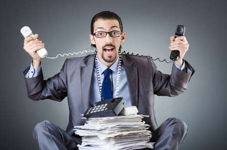 Man with clock and pile of papers Stock Photo - 18037029