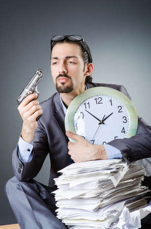 Man with clock and pile of papers Stock Photo - 18037686