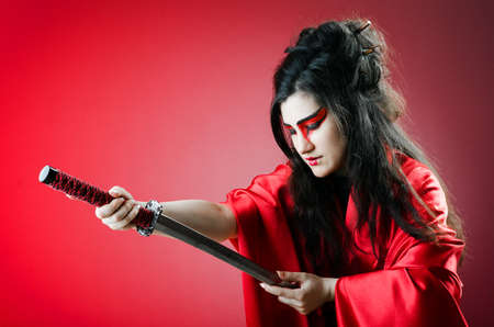 Female sword warriod in dark studio Stock Photo
