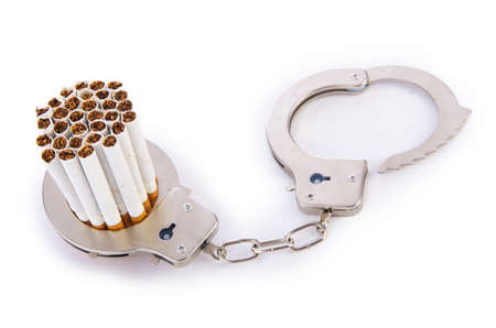Addition concept with cigarettes and handcuffs Stock Photo - 18011208