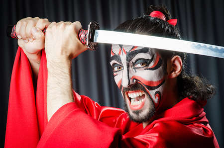 Man with sword and face mask Stock Photo - 18037729