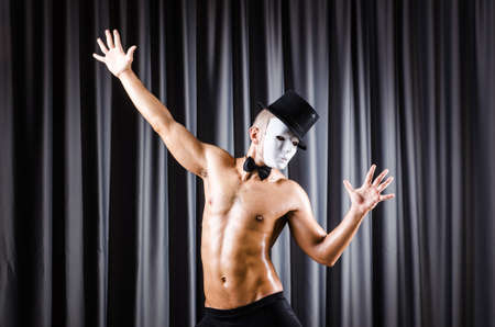 Muscular actor with mask against curtain Stock Photo - 18037160