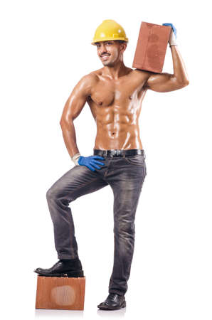 Sexy construction worker with bricks photo
