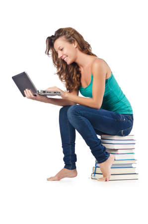 Student with netbook sitting on books Stock Photo - 18037405