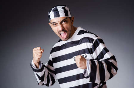 Convict criminal in striped uniform Stock Photo - 18037030