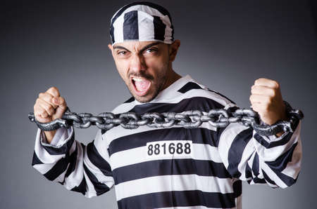 Convict criminal in striped uniform Stock Photo - 18037033