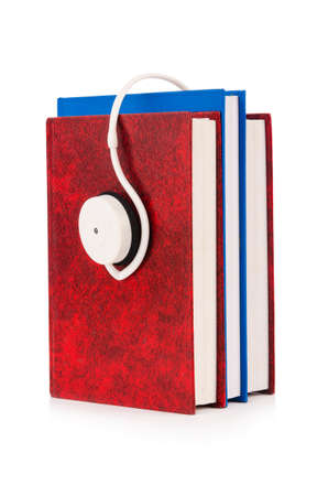 Concept of audio books with earphones on white Stock Photo - 18013444