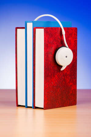 Concept of audio books with earphones on white photo