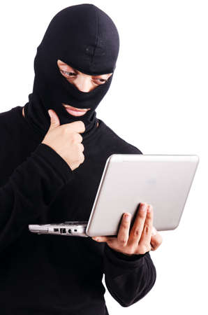 Hacker with computer wearing balaclava Stock Photo - 18037458