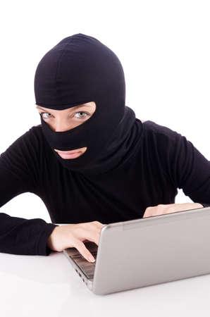 Hacker with computer wearing balaclava Stock Photo - 18037612
