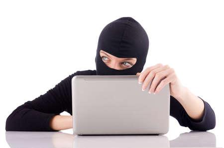 Hacker with computer wearing balaclava Stock Photo - 18037367