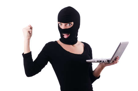 Hacker with computer wearing balaclava Stock Photo - 18037432