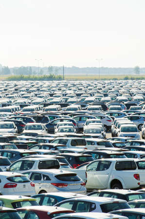 TUSCANY, ITALY - 27 June: New cars parked at distribution center in Tuscany, Italy. This one of biggest distribution centers in Italy. Stock Photo - 18171534