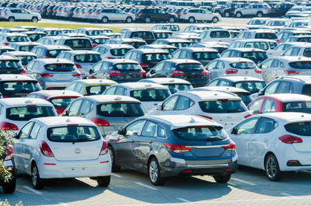 a lot of: TUSCANY, ITALY - 27 June: New cars parked at distribution center in Tuscany, Italy. This one of biggest distribution centers in Italy.
