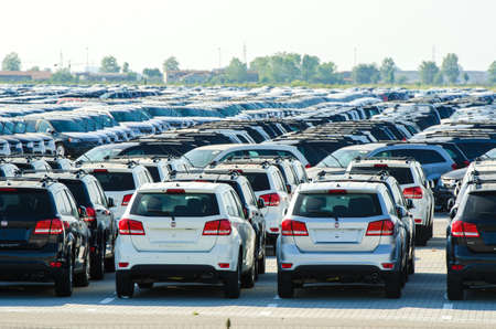 TUSCANY, ITALY - 27 June: New cars parked at distribution center in Tuscany, Italy. This one of biggest distribution centers in Italy. Stock Photo - 18171530