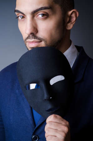 Man with black mask in studio Stock Photo - 18636738