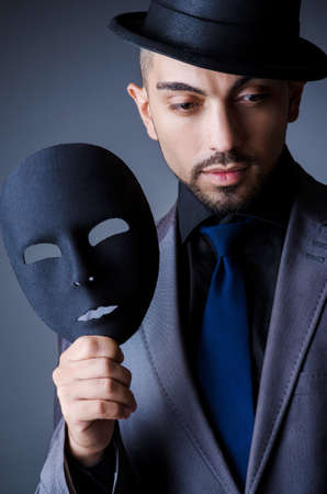 Man with black mask in studio Stock Photo - 18662873