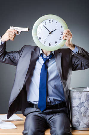 Man with clock and pile of papers Stock Photo - 18174115
