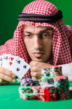 arabic number: Arab playing in casino - gambling concept with man