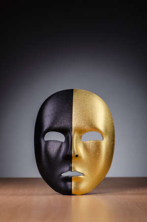 Mask against the dark background photo
