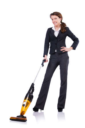 Young woman doing vacuum cleaning photo