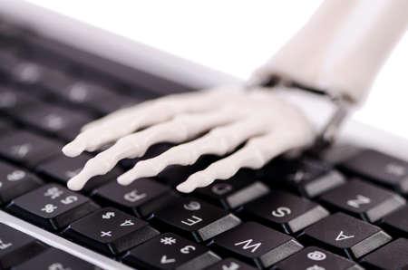 Skeleton working on the keyboard Stock Photo - 18175280