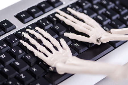Skeleton working on the keyboard Stock Photo - 18175281