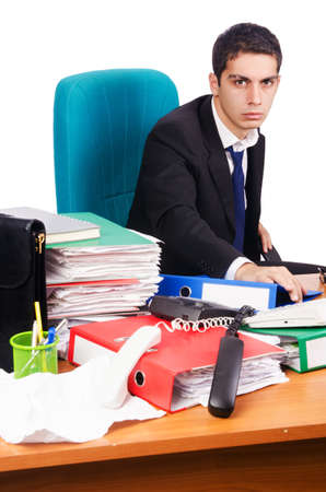 Young busy businessman at his desk Stock Photo - 18636717