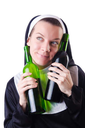 Nun with bottle of red wine Stock Photo - 18636701