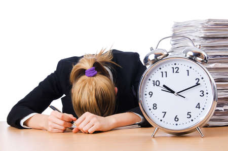 Woman businesswoman with giant alarm clock Stock Photo