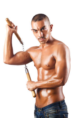 attacker: Man in martial arts concept with nunchucks Stock Photo