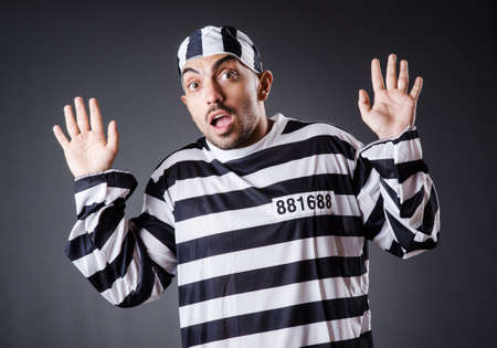 Convict criminal in striped uniform Stock Photo - 18662782