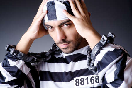 Convict criminal in striped uniform Stock Photo - 18662868