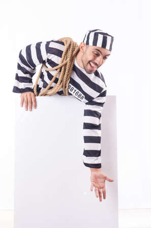 Convict criminal in striped uniform Stock Photo - 18636549