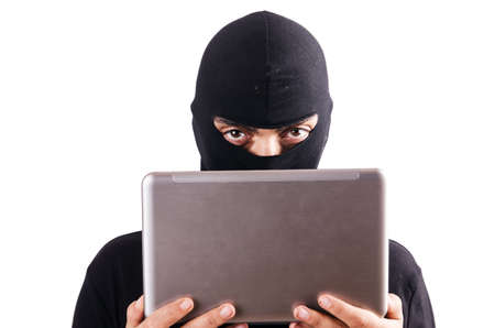 Hacker with computer wearing balaclava Stock Photo - 18232103