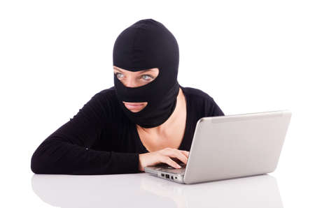 Hacker with computer wearing balaclava Stock Photo - 18636526