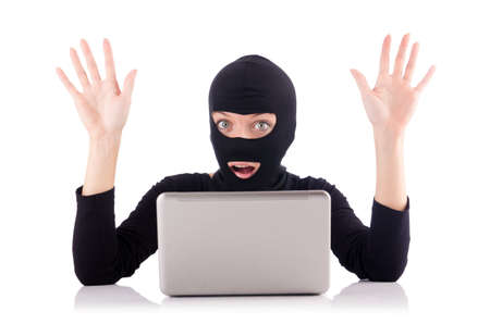 Hacker with computer wearing balaclava Stock Photo - 18636490